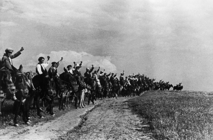 SPAIN. Extremadura. A committee of peasants saluting, with their fists, militians leaving to join the forces in Madrid. 1936.